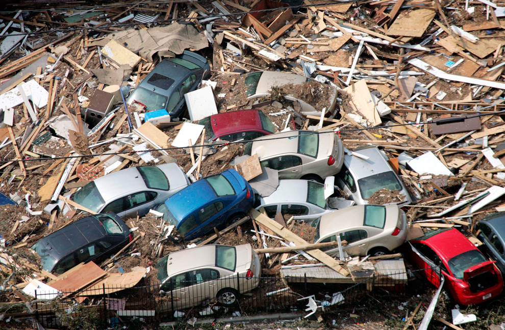 Cars lie piled up among other debris from Hurricane Katrina in Gulfport, Mississippi on Wednesday, Aug. 31, 2005. (AP Photo/David J. Phillip)